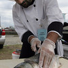 Gloucester: Chef Jeremy Guyotte of Passports Restaurant filets a bluefish during the Seafood Throwdown against Dog Bar Restaurant at the Cape Ann Farmers Market yesterday afternoon. Dog Bar won the challenge and proceeds from the event were being donated to Horizon Relief, which is helping fishermen in the Gulf of Mexico whose lives have been impacted by the BP oil disaster. Photo by Kate Glass/Gloucester Daily Times