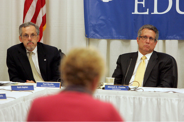 Malden: Paul Reville, the governor's secretary of education, left, and Mitchell Chester, the state commissioner of education, listen to Val Gilman, chair of the school committee, during a hearing to determine the future of the new Gloucester charter school at the State Department of Education offices in Malden Friday afternoon. Mary Muckenhoupt/Gloucester Daily Times