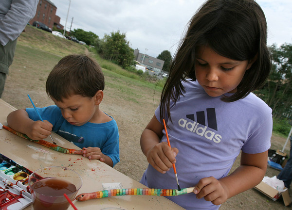Gloucester: Michael Gibbs, 3, and Jillian Gibbs, 9, paint wooden snakes at the Cape Ann Vernal Pond Team booth at the Cape Ann Farmers Market on Thursday. They had several live snakes with them and ran a demonstration during the market. Photo by Kate Glass/Gloucester Daily Times