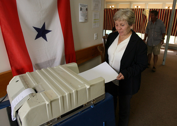 Gloucester: Marcia Perkins of Gloucester casts her ballot in Tuesday's primary at the Veterans' Center yesterday afternoon. Photo by Kate Glass/Gloucester Daily Times