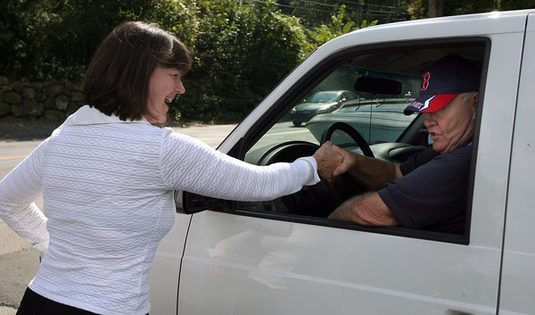 Gloucester: Janet Holmes, a Rebublican write-in candidate for the state's 5th Essex District House of Representatives seat, greets Marty Jacobs outside West Parish Elementary School while campaigning yesterday. Photo by Kate Glass/Gloucester Daily Times