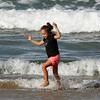 Rockport: Mya Doucette, 6, of Rockport dances through the waves at Back Beach while enjoying the last bit of warm sunshine Wednesday afternoon. Mary Muckenhoupt/Gloucester Daily Times
