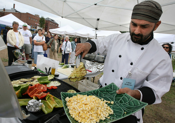 Gloucester: Chef Jeremy Guyotte of Passports Restaurant pulls eggplant off the grill during the Seafood Throwdown at the Cape Ann Farmers Market yesterday afternoon. Dog Bar won the challenge and proceeds from the event were being donated to fishermen in the Gulf of Mexico whose lives were impacted by the BP oil disaster. Photo by Kate Glass/Gloucester Daily Times