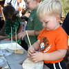 Essex: Mason Gadbois, 2, and his brother, Fisher Gadbois, 4, make wooden schooners at the Essex Shipbuilding Museum on Monday as part of Frame Up! In the Basin. Photo by Kate Glass/Gloucester Daily Times