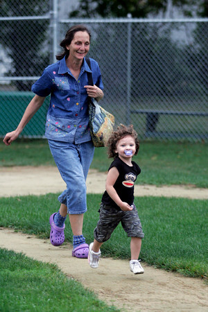 Manchester: Dawn Murdock chases her granddaughter, Lily Genest, around the bases at Masconomo Park yesterday afternoon. Photo by Kate Glass/Gloucester Daily Times
