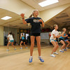 Manchester: Nicole Frenkel, 12, jumps and spins around while training with John Boyle at the Manchester Athletic Club with her friends, Ellyse Hamlin, 13, Meghan Kelley, 12, and Amanda Mohan, 12, right, Thursday afternoon. The Manchetser Athletic Club is hosting a Youth Triathalon this Sunday for children ages 5-14 at 10 a.m.. Mary Muckenhoupt/Gloucester Daily Times