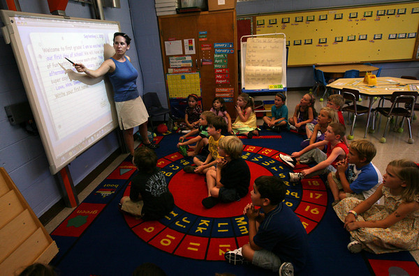 Essex: Emily Dwyer reads a welcome letter to her first grade class at Essex Elementary School during their first day of class yesterday. Photo by Kate Glass/Gloucester Daily Times