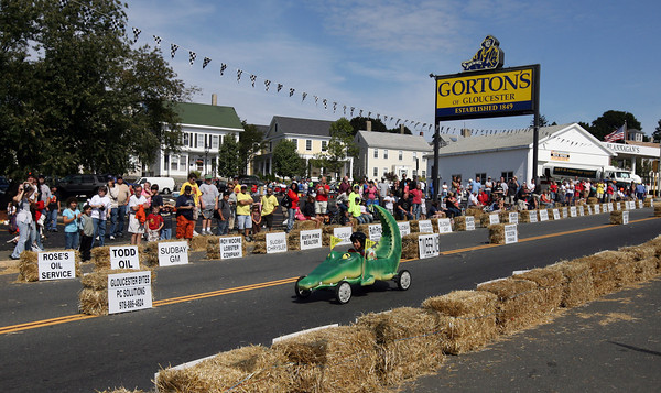 "Gloucester: Ezra Mendoza navigates the ""Croc Rocket"" down the hill during the Fish Box Derby on Rogers Street yesterday. Although Mendoza did not make it to the finals, his vehicle was a crowd favorite. Photo by Kate Glass/Gloucester Daily Times"