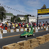 """Gloucester: Ezra Mendoza navigates the """"Croc Rocket"""" down the hill during the Fish Box Derby on Rogers Street yesterday. Although Mendoza did not make it to the finals, his vehicle was a crowd favorite. Photo by Kate Glass/Gloucester Daily Times"""