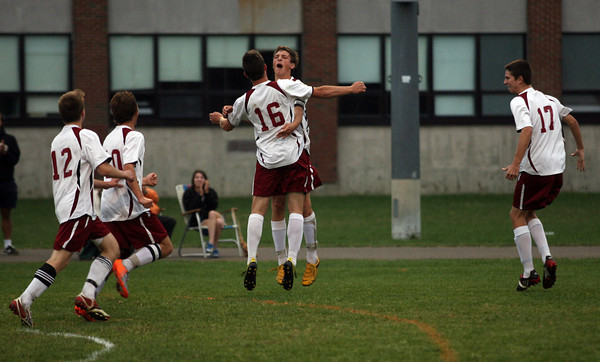 Rockport: Rockport's Andrew Burnham leaps in the air with teammate Cam Tibert (16) to celebrate Tibert's goal against Manchester Essex during the first half of their game at Rockport High School last night. Photo by Kate Glass/Gloucester Daily Times<br /> , Rockport: Rockport's Andrew Burnham leaps in the air with teammate Cam Tibert (16) to celebrate Tibert's goal against Manchester Essex during the first half of their game at Rockport High School last night. Photo by Kate Glass/Gloucester Daily Times