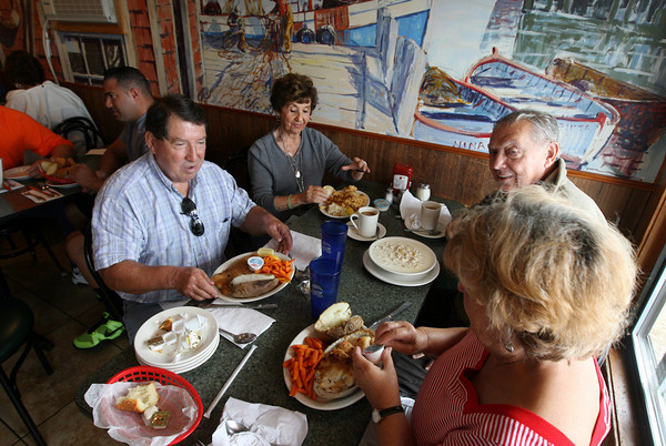 Gloucester: Siblings Richie Madina, Fran Gray, Frank Madina and Phyllis Silke have lunch at the Causeway yesteray afternoon. The four go out to lunch every Tuesday and come to the Causeway at least once a month. Photo by Kate Glass/Gloucester Daily Times