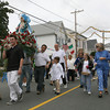 Gloucester: The Mother of Grace statue is carried down Washington Street during the Mother of Grace Club Parade on Sunday, the final day of their annual fiesta. This year marks the 66th year of the fiesta. Photo by Kate Glass/Gloucester Daily Times