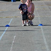 Gloucester: Ann Wilder coaches her son, Daniel Wilder, 2, at the start of the 2-3 year-old kids race at O'Maley Middle Schoon on Monday morning. Photo by Kate Glass/Gloucester Daily Times