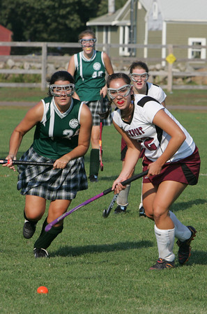Rockport: Rockport's Sabrina McCarthy, right, and Manchester Essex's Maddy Huleatt run for possession of the ball during the field hockey game held at Rockport High School Wednesday afternoon. Manchester Essex defeated Rockport 1-0. Mary Muckenhoupt/Gloucester Daily Times