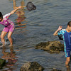 Gloucester: Kiley Taylor, 8, and her brother C.J., 7, look for any signs of life in the creek by Good Harbor Beach Wednesday afternoon. Mary Muckenhoupt/Gloucester Daily Times