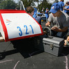 Gloucester: Pat Vitale makes adjustments to the family's car as his sons, Aubrey, 9, left, and Justin, 8, right, look on during the Fish Box Derby on Rogers Street yesterday. Justin was driving the car this year, Aubrey drove last year, and their older sister, Jesse, drove it in 2006. Photo by Kate Glass/Gloucester Daily Times