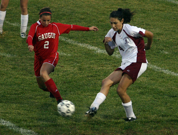 Gloucester: Gloucester's Nicole Reppucci keeps the ball away from Saugus' Jackie Russo during their game at Newell Stadium last night. Photo by Kate Glass/Gloucester Daily Times