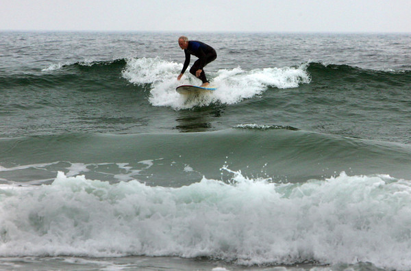 Gloucester: Jack Clark of Gloucester catches a wave while taking advantage of the high surf from hurricane Earl at Good Harbor Beach Friday afternoon. Waves should be the most intense on Saturday and swimmers are asked to beware of strong rip tides through Labor Day weekend. Mary Muckenhoupt/Gloucester Daily Times
