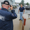 Gloucester: Homeland security officers great and observe passengers of the cruise ship Eurodam as the come to shore wednesday morning at Cruise Port. Desi Smith/Gloucester Daily Times. September 8,2010