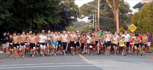 Gloucester: Runners compete for a good position at the start of the 34th Annual Magnolia 5K Road Race yesterday evening. Photo by Kate Glass/Gloucester Daily Times