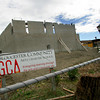 Gloucester: Contruction continues of the new Gloucester Charter School with the openign of the school still on hold. Here men work on building the school's new gymnasium.  Mary Muckenhoupt/Gloucester Daily Times