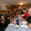 Gloucester: Annette Marston chats with Joe Ward while filling a soda at the Causeway yesterday afternoon. Ward is a big fan of the restaurant's fish chowder and Italian shrimp. Photo by Kate Glass/Gloucester Daily Times