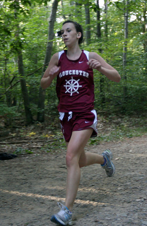 Gloucester: Gloucester's Cecily Francis approaches the finish line during a cross country meet against Winthrop at Ravenswood Park yesterday. Francis won the race with a time of 21:06. Photo by Kate Glass/Gloucester Daily Times