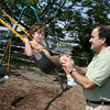 Manchester: Chris Brown pushes his son, Nick Brown, 3, on the swings at Masconomo Park yesterday afternoon. Photo by Kate Glass/Gloucester Daily Times