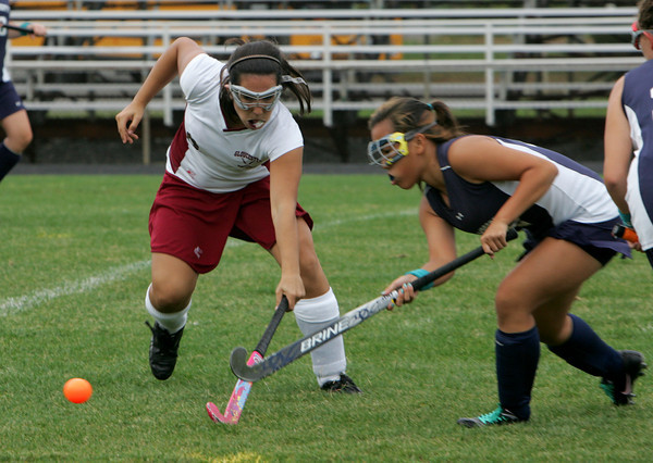 Gloucester: Gloucester's Andie-Jane Phinney goes after the ball with Swampcott's Lisa Vu during the field hockey game at Newell Stadium Thursday afternoon.  Mary Muckenhoupt/Gloucester Daily Times