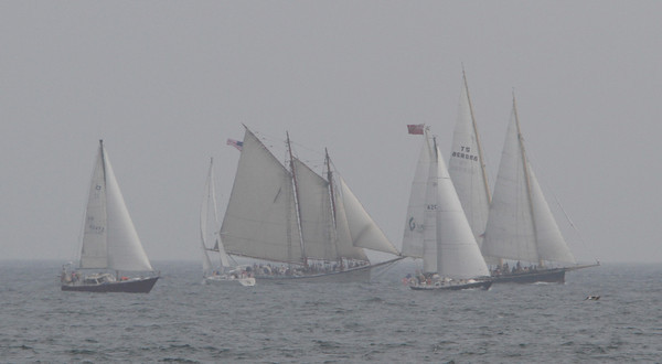 A small pack of boats race during the Schooner Festival on Sunday afternoon. David Le/Gloucester Daily Times.