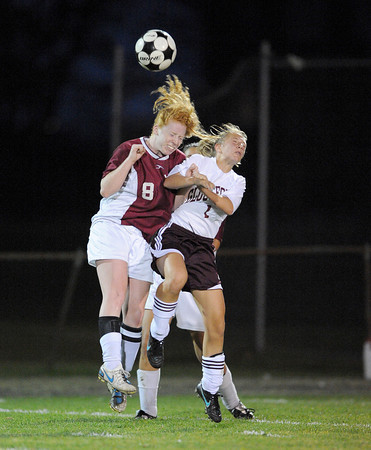 Gloucester:  Gloucester's Elle Wierbicky goes head to head with Lynn English's Mackenzie Clark,last night at Newell Stadium. Desi Smith/Gloucester Daily Times. September 28, 2011