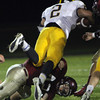 Gloucester High School sophmore Michael Falzarano brings down Andover running back Andy Coke during their game on Friday evening. David Le/Gloucester Daily Times