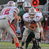Manchester:  Amesbury's QB  Matt Talbot feels the pressure from Manchester's Mavrick MacEachern#7 and Cory McCollum#57 last night at MERHS.  Desi Smith/Gloucester Daily Times. September 9, 2011