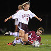 Gloucester:  Gloucester's Melodie Orrel takes the ball away form a downed Nicolette Angelli of Lynn English, last night at Newell Stadium. Desi Smith/Gloucester Daily Times. September 28, 2011
