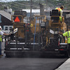 Construction workers pave Main St. in Essex on Friday afternoon near the intersection of Routes 22 and 133. David Le/Gloucester Daily Times.