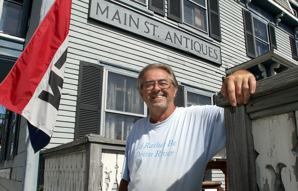 Bob Coviello, owner of Main St. Antiques, stands outside his store on Wednesday. The construction that has been going on all along Main St. is almost finished and the stores along Main St. hope business will return to how it was before construction started. David Le/Gloucester Daily Times