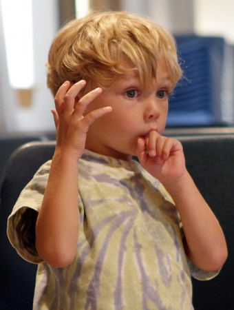 Anderson DeLuca, 3, from the Sandy Bay Preschool, reacts to a story being read at Rockport Public Library during the storytime hour on Tuesday. David Le/Gloucester Daily Times
