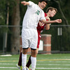 Manchester-Essex sophomore Sean Guitierrez heads the ball as he battles for position with and Newburyport player. David Le/Gloucester Daily Times