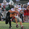 Manchester:  Amesbury's QB  Matt Talbot gets taken down by Manchester's  Cory McCollum #57 last night at MERHS.  Desi Smith/Gloucester Daily Times. September 9, 2011