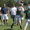 Manchester-Essex Jr. Hornets quarterback Cosmo Pallazolla, throws a pass in front of the coaches and before one of his teammates could deflect the ball during practice. David Le/Gloucester Daily Times