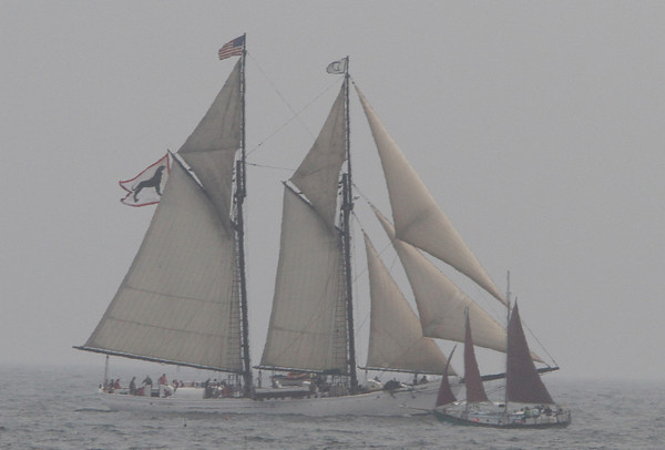 Two schooners pass each other as they compete in one of the Schooner Festival's races on Sunday. David Le/Gloucester Daily Times.
