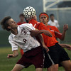 Gloucester's Matt Carpenter, left, gets tangled with Beverly's Cam Rogers as the two battle for possession during their game on Thursday evening. David Le/Gloucester Daily Times
