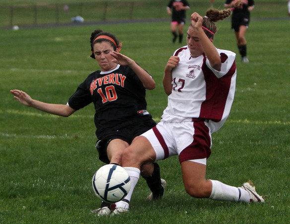 Gloucester High School midfielder Bianca Giacalone, right, collides with Beverly's Kristen O'Connor on a 50/50 ball in the first half of play on Tuesday evening. David Le/Gloucester Daily Times