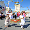 Gloucester: Sophia Ferrara 3, and Laexes Thomas 4, get ready to parade down Washington St Sunday afternoon from the Mother of Grace Club, ending the annual nine-day veneration of Mary, Mother of God  . A closing candlelight procession will be held Sunday night at 8:45 at the club.    Desi Smith/Gloucester Daily Times. September 11, 2011