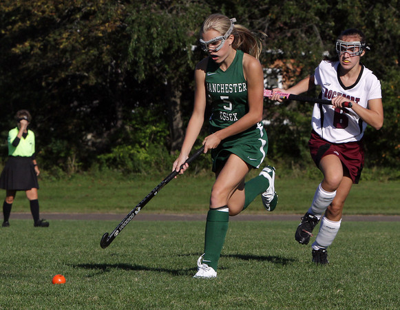 Manchester-Essex's Taylor Meek, left, controls the ball while Rockport's Eliza Ottenheimer, right, tries to chase her down. David Le/Gloucester Daily Times