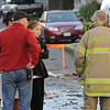 Gloucester: Detective Steve Mazzoni and firefighter Mike Sonia talk with a couple returning to see if they could try to retreive any thing for their apartment that was distroyed by fire the night before. The couple was turned away because the building was deemed unsafe.    Desi Smith/Gloucester Daily Times. September 16, 2011