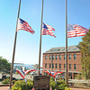 Gloucester: Patrolmen Mark Foote who was a driving force on getting a memorial site at the Police Station, for past police officers and to honor those who gave their lives to serve this country, spent the last few days planting flowers, getting three new flags and working on getting the memorial site ready in time to honor those who lost their lives 10 years ago on 9/11 in New York.   Desi Smith/Gloucester Daily Times. September 11, 2011