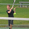 Gloucester: Ben Frick 13, returns a serve against Art Rose in a singles match Saturday morning at Bass Rocks Open Tennis Tourney.  Desi Smith /Gloucester Daily Times. September 3,2011