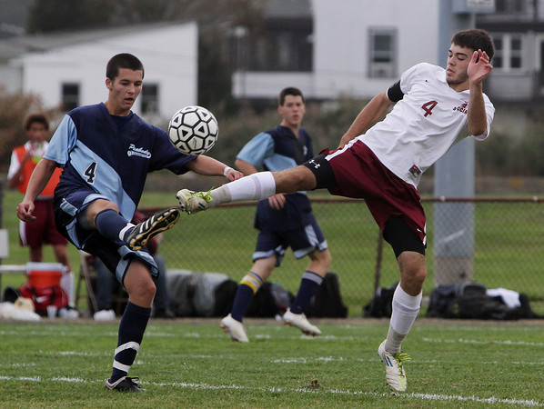 Gloucester captain JJ Palazzola, right, and Peabody's John Ramsey, battle for a 50/50 ball on Wednesday at Newell Stadium. David Le/Gloucester Daily Times