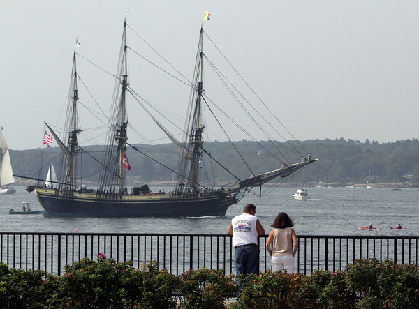 Claudette and Scott Forbes, of Billerica, stand and watch the Friendship, of Salem, MA, pass by at the Fort playground during the Parade of Sail on Sunday morning. David Le/Gloucester Daily Times